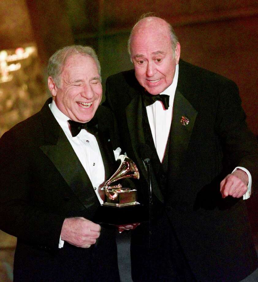 "FILE - In this Feb. 24, 1999 file photo, Mel Brooks, left, and Carl Reiner accept their award for best spoken comedy album, ""The 2000 Year Old Man in the Year 2000,"" during the 41st Annual Grammy Awards in Los Angeles. Reiner, the ingenious and versatile writer, actor and director who broke through as a a€œsecond bananaa€ to Sid Caesar and rose to comedya€™s front ranks as creator of a€œThe Dick Van Dyke Showa€ and straight man to Mel Brooksa€™ a€œ2000 Year Old Man,a€ has died, according to reports. Variety reported he died of natural causes on Monday night, June 29, 2020, at his home in Beverly Hills, Calif. He was 98. (AP Photo/Kevork Djansezian, File) Photo: Kevork Djansezian / AP1999"