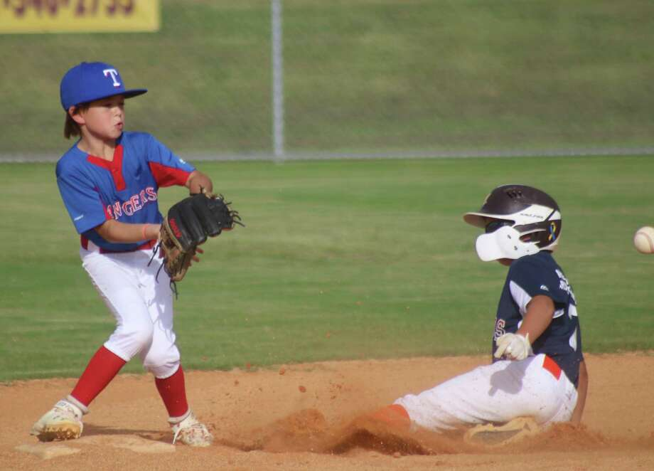 Slade Cox slides into second base with the steal, allowing a runner on third to steal home with the third run Tuesday night. Aysen Miller is the Rangers player attempting to take the late throw. Photo: Robert Avery
