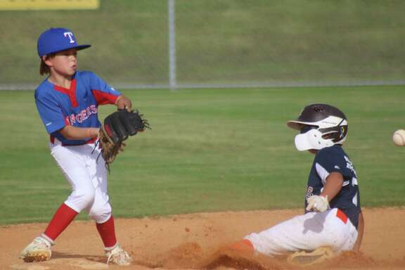 Slade Cox slides into second base with the steal, allowing a runner on third to steal home with the third run Tuesday night. Aysen Miller is the Rangers player attempting to take the late throw.