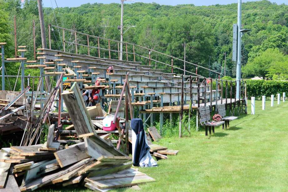 The old home bleachers are torn down ahead of the construction of new and improved bleachers at Lockhart Field. (Photo/Colin Merry)