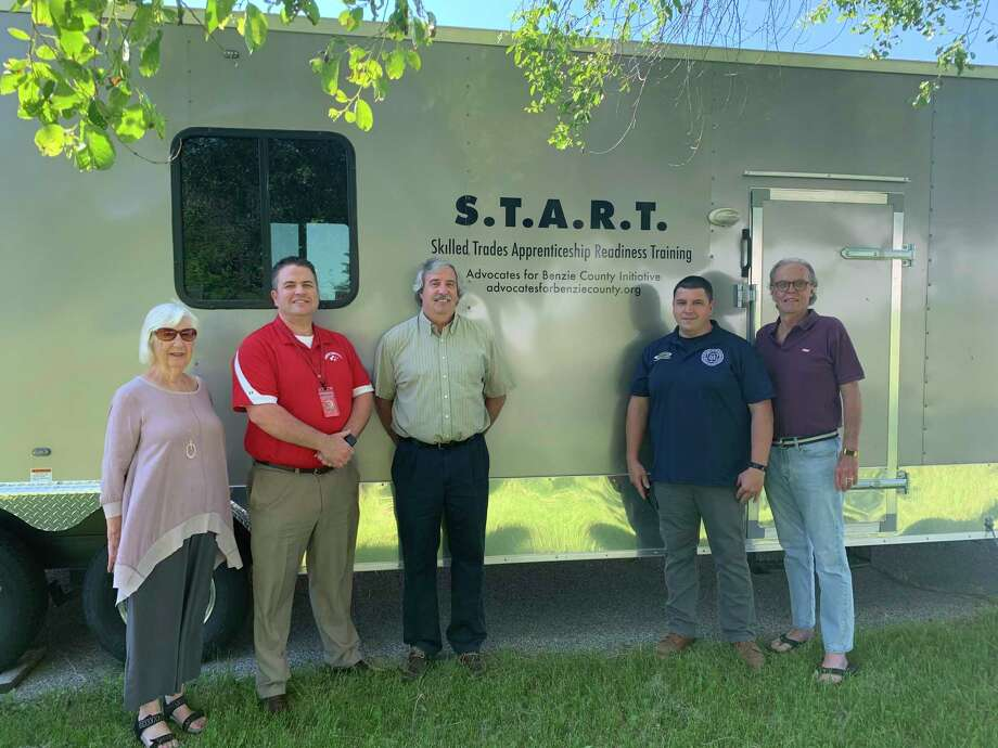 Advocates for a Benzie County gifted the two school districts with the mobile classroom and tools from the START program. Pictured (from left to right) are Kay Bond, executive director of Advocates for Benzie County; Matt Olson, superintendent Benzie Central Schools; Jeff Tousley, superintendent Frankfort Elberta Schools; Jason Reed, Michigan Regional Council of Carpenters; and John E. Harnish, president of Advocates for Benzie County. (Submitted photo)