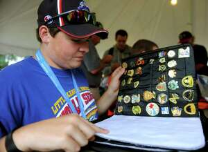Clayton Gummo, 15, of Mill Hall, Pennsylvania, looks through his pin collection while trading with other enthusiasts outside Volunteer Stadium during the Little League World Series in Williamsport, Penn., on Tuesday, August 24, 2010.