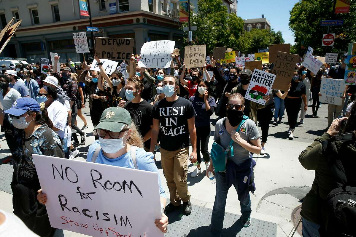 Demonstrators march on pour onto Sproul Plaza at UC Berkeley after marching from the Rockridge BART station in Oakland on Saturday, June 13, 2020 to protest for racial justice and against excessive police force.