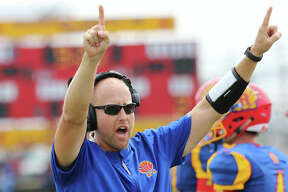 Roxana coach Wade DeVries signals for the PAT unit after a Shells touchdown in last season's opener at Raich Field in Roxana. DeVries, in his second year at Roxana, is the 2019 Telegraph Small-Schools Football Coach of the Year.
