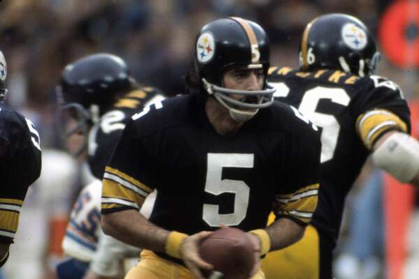 Terry Hanratty #5 of the Pittsburgh Steelers turns to hand the ball off to a running back against the Denver Broncos during an NFL football game November 18, 1973, at Three Rivers Stadium in Pittsburgh, Pennsylvania. Hanratty played for the Steelers from 1969-75.