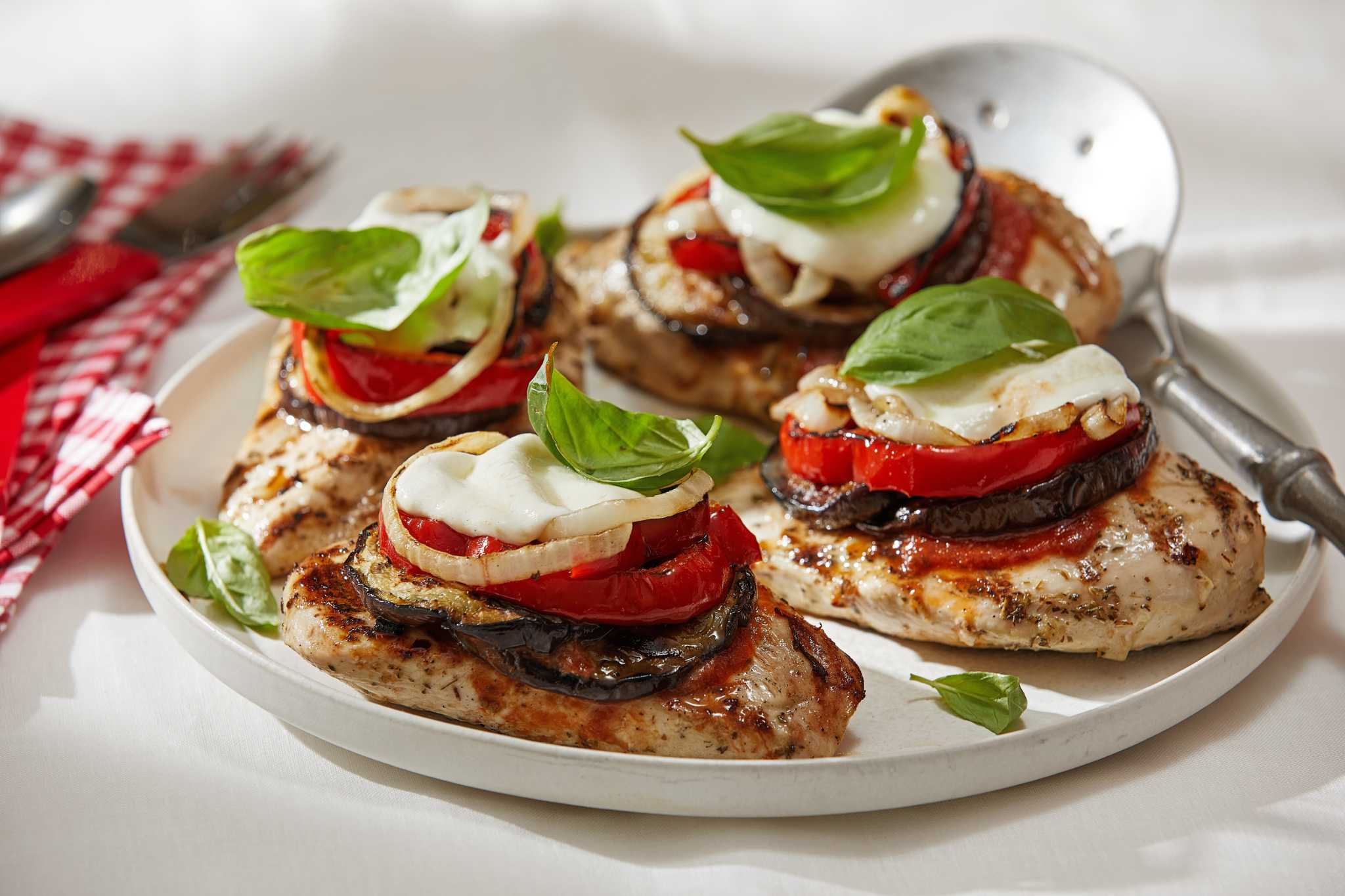 Mozzarella and marinara turn grilled chicken and vegetables into a summertime hit