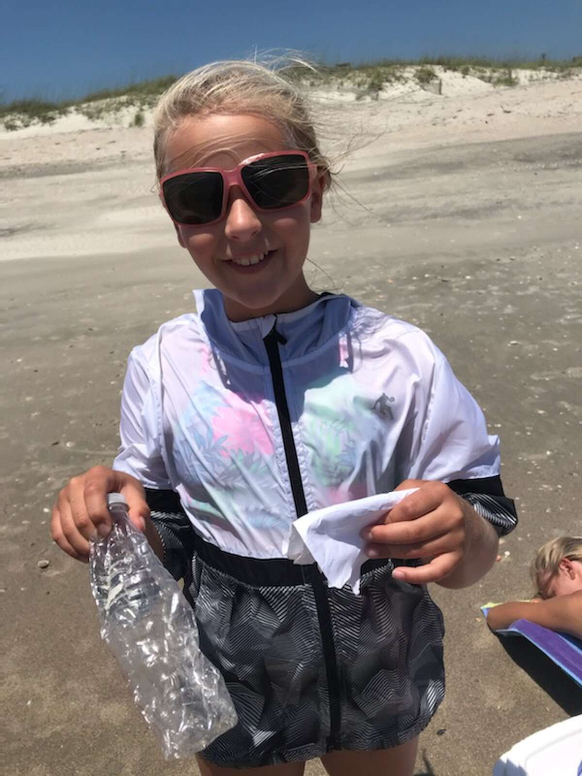 Sarah Beth Walters holds the bottle and note that she found at Holden Beach in North Carolina on June 3.