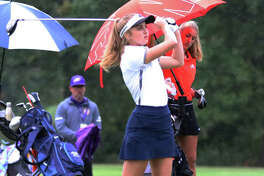 Father McGivney's Ellie Hyten watches her drive off the first hole last year in the Class 1A girls golf regional at Spencer T. Olin in Alton. Hyten shot 103 to advance to the sectional.