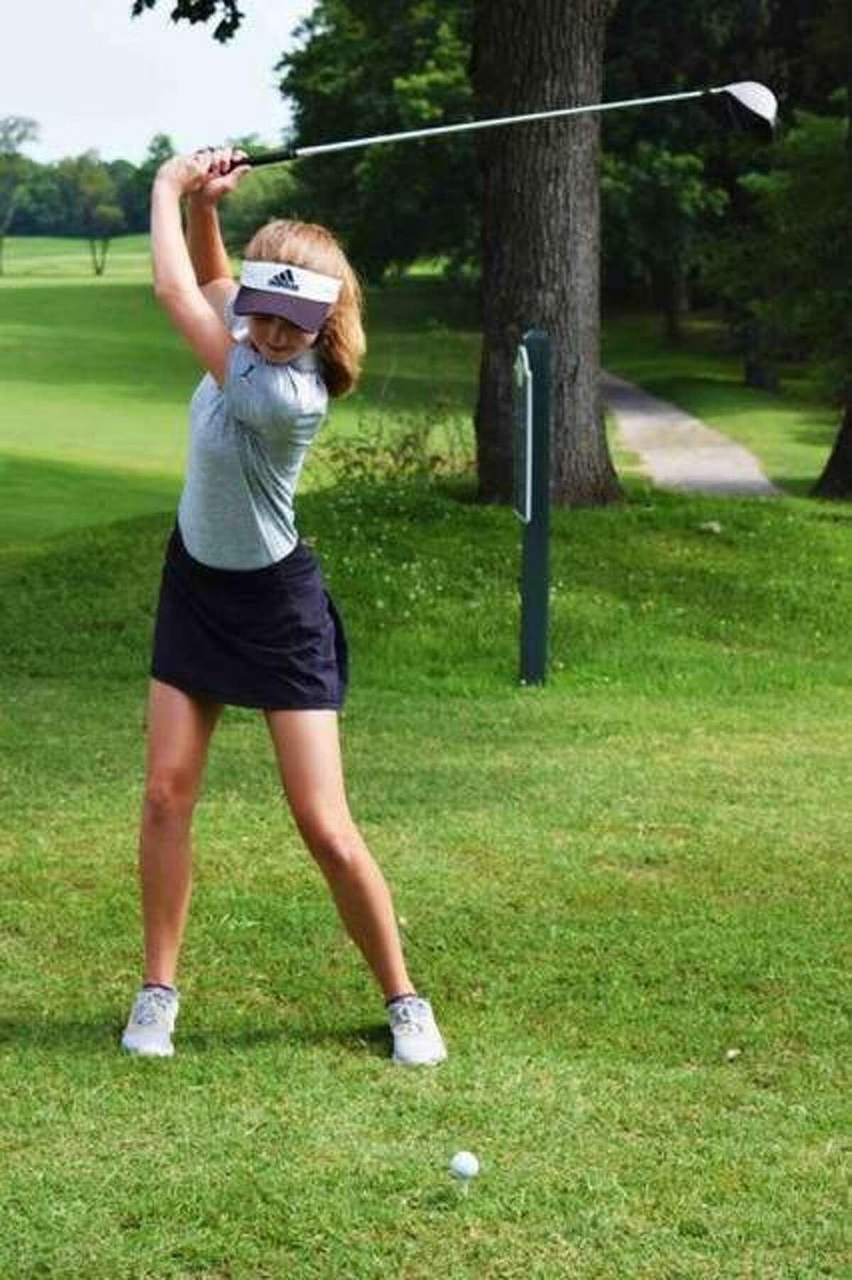 FMCHS sophomore Ellie Hyten practices her tee shots at Oak Brook Golf Club in Edwardsville.