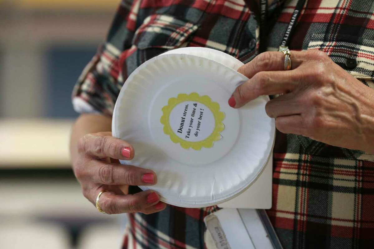 Fourth graders are handed plates with words of encouragement at Kindred Elementary School before taking the STAAR test in 2018. Pre-K students made doughnuts for the fourth graders.