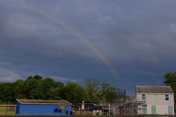 A rainbow shows its colors over Kiwanis Field on Saturday, June 27, 2020, in Fairfield, Conn.