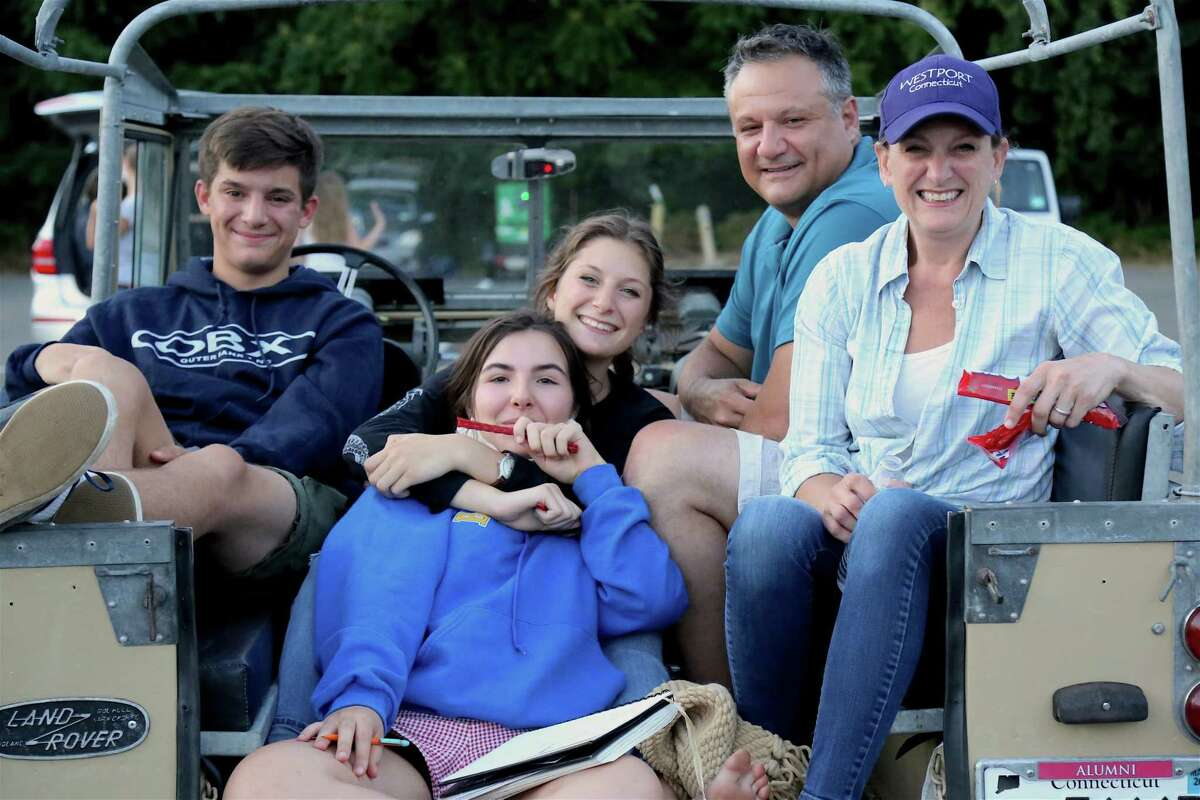 Paige Toglia of Westport, front center, joins the D'Ana family of Westport, including, from left, Oliver, Charlotte, Joe, and Alicia at the drive-in premiere of the new Remarkable Theater on Friday, June 27, 2020, in Westport, Conn.