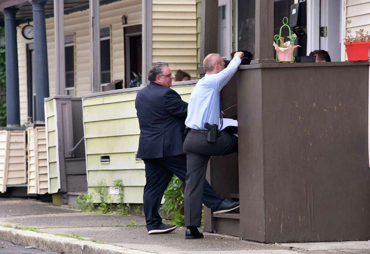 Investigators are seen questioning neighbors near the scene where 18-year-old Tyshawn Daniels died after he was shot twice on the street on Wednesday, July 1, 2020 in Cohoes, N.Y. (Lori Van Buren/Times Union)