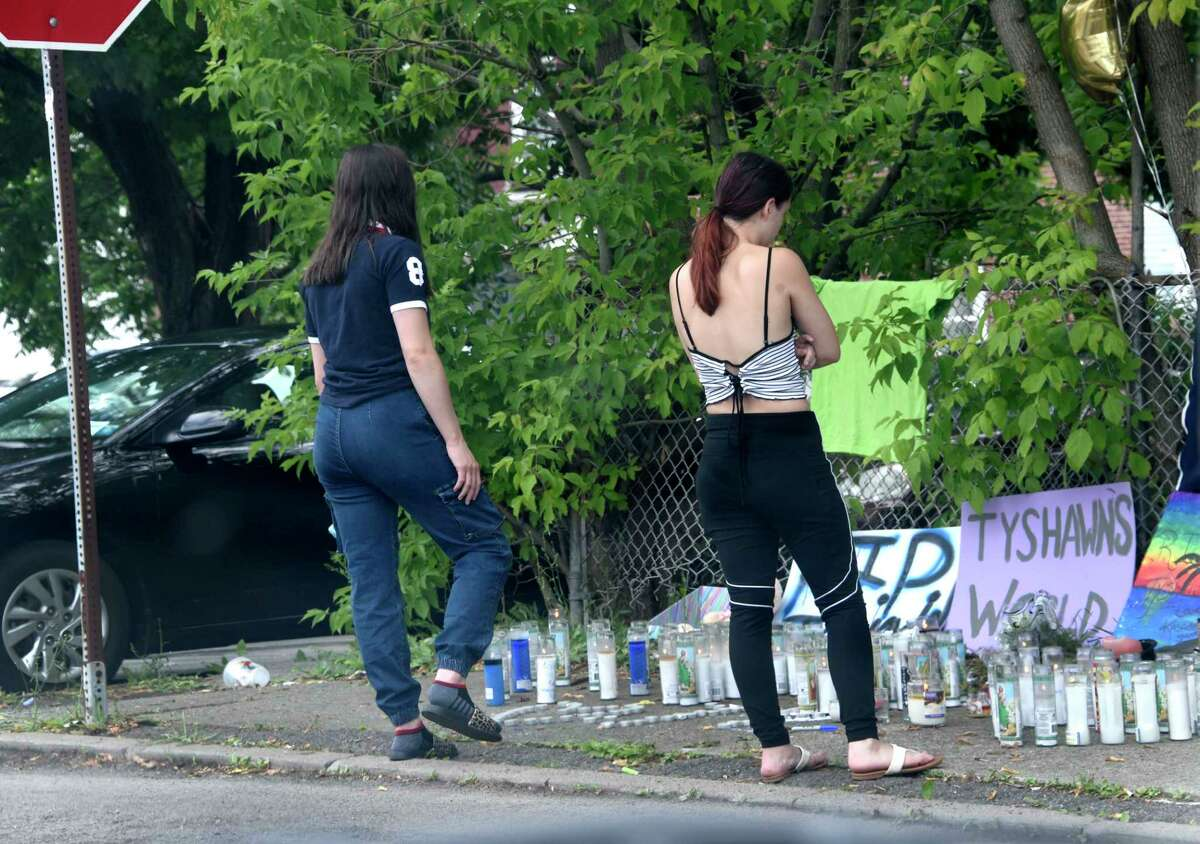 A couple girls visit a memorial at the scene where 18-year-old Tyshawn Daniels died after he was shot twice on the street on Wednesday, July 1, 2020 in Cohoes, N.Y. (Lori Van Buren/Times Union)