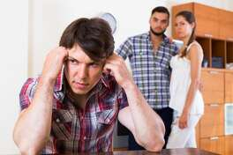 Sad young man and couple at home: problems of love triangle
