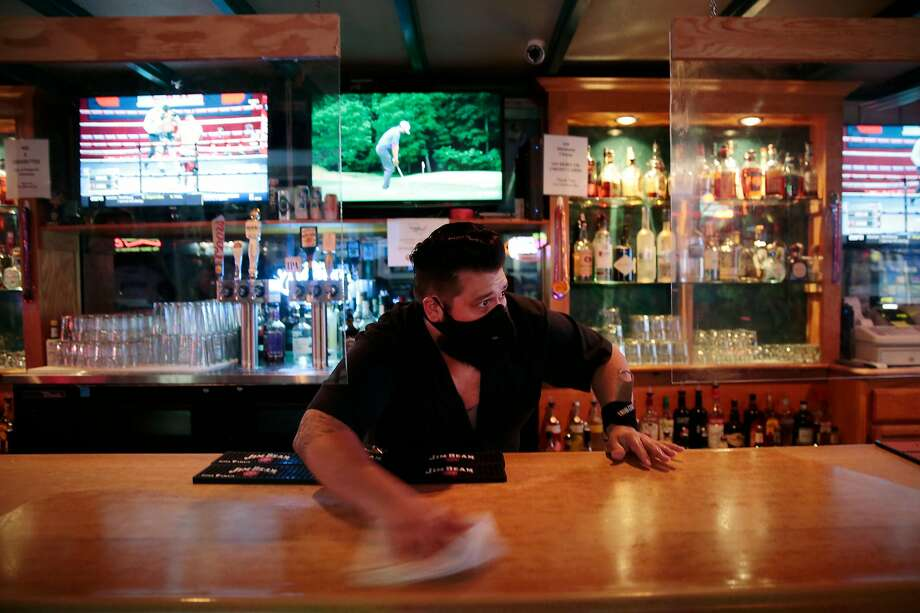 Manager Kevin Lemus cleans the bar at the Hideaway in Petaluma. Photo: Ramin Rahimian / Special To The Chronicle