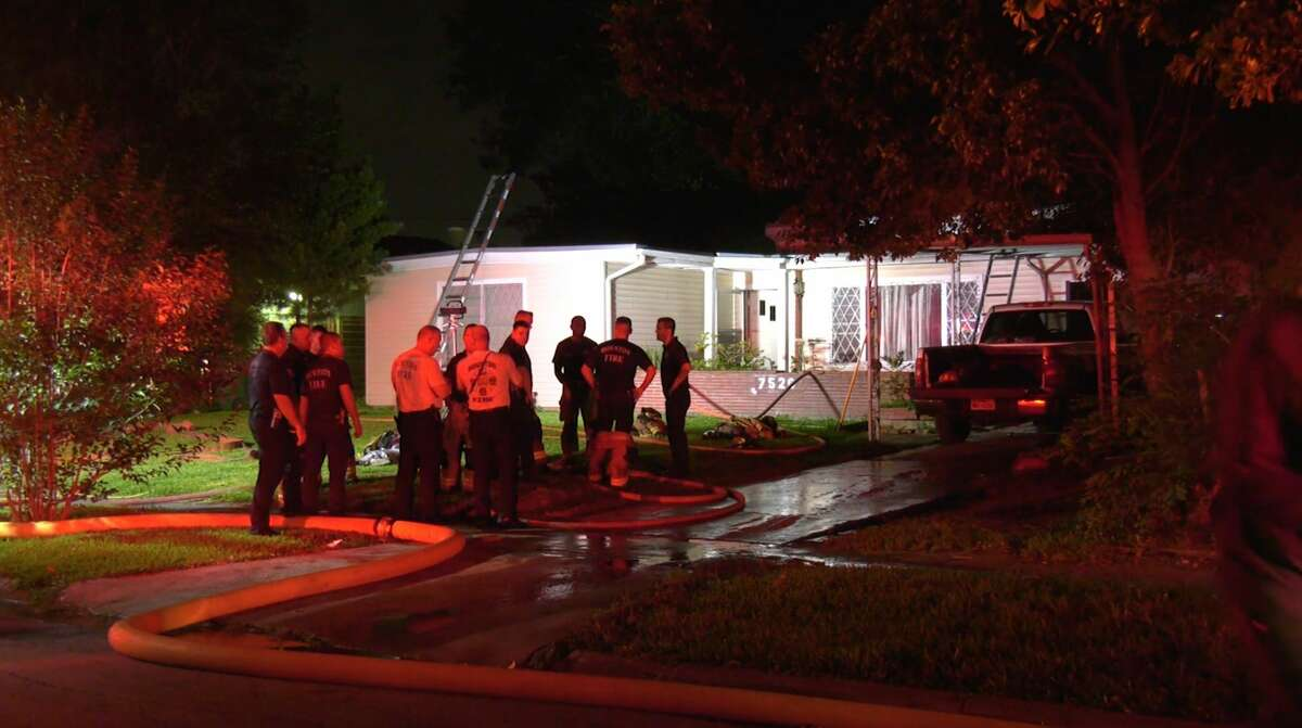Houston firefighters work the scene of a house fire in the 7500 block of Oak Vista Drive on Tuesday, June 30, 2020.