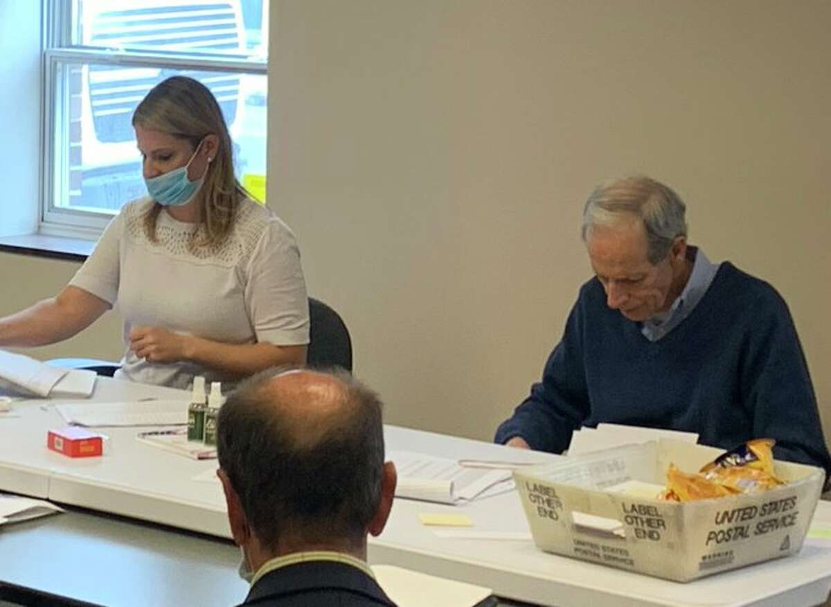 Albany County's Democratic Elections  Commissioner Matt Clyne is photographed not wearing a mask during ballot counting this week in Albany. The county's legislature chairman, Andrew Joyce, said Clyne's decision is reason to replace him.