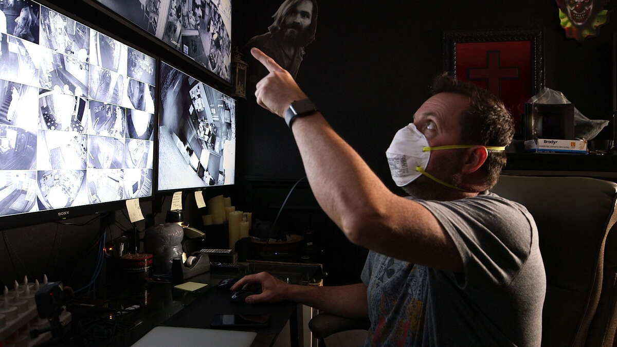 Billy Tolley examines unusual activity on the team's monitor in Ghost Adventures_Quarantine. (Courtesy of Travel Channel)