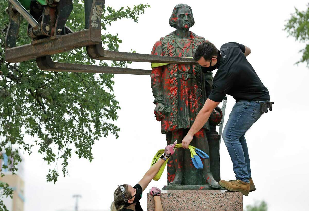Workers hired by the City of San Antonio carefully remove the statue.