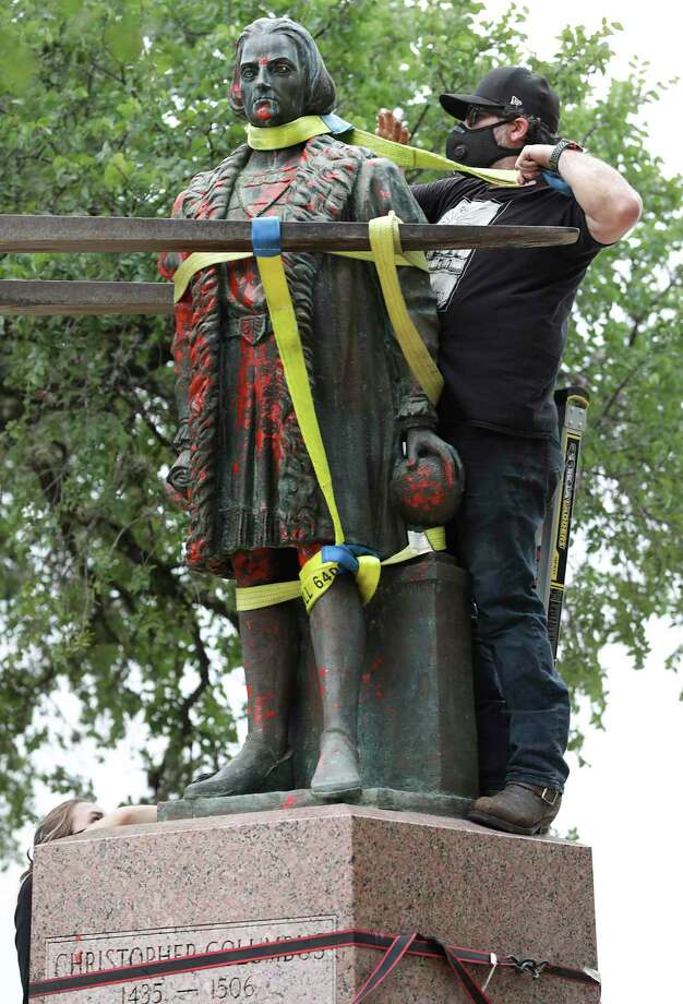 The Columbus statue, in place since 1957, was affixed to the pedestal with bolts that have since rusted out. Photo: Bob Owen /San Antonio Express-News / ©2020 San Antonio Express-News