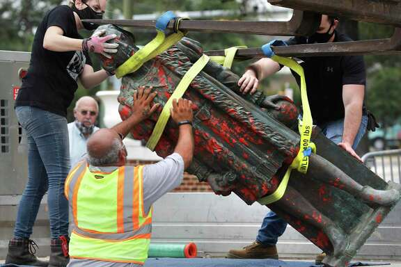 Workers hired by the city on Wednesday remove the statue of Christopher Columbus from Columbus Park. A reader sees the removal  as pandering by elected officials to would-be voters.