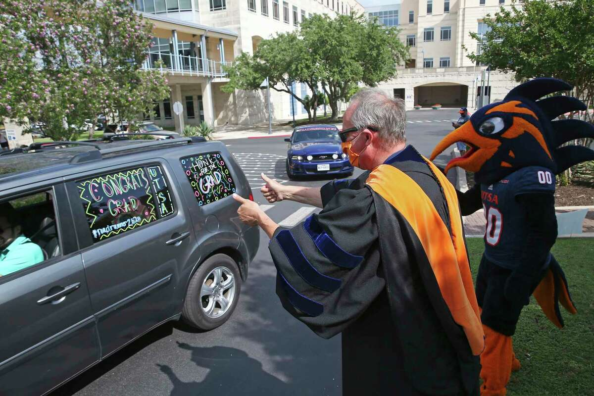 UTSA President Taylor Eighmy and Rowdy the Roadrunner greet graduates as the Class of 2020 drives through the Main Campus on May 22. About 100 vehicles participated in the drive after commencement ceremonies were cancelled throughout the U.S. due to coronavirus concerns.