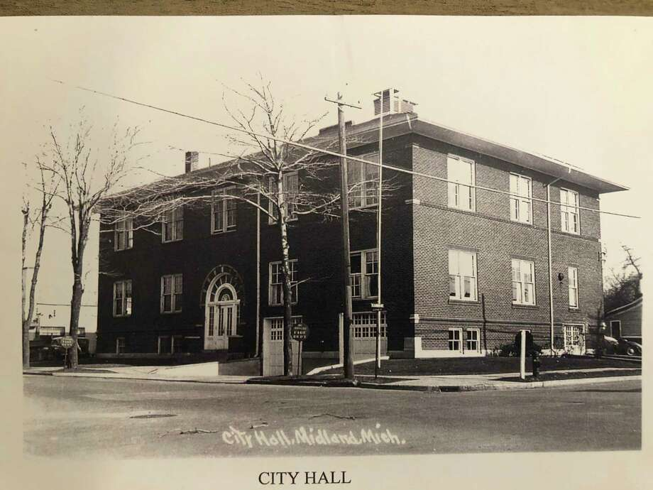 This is a photo of the remodeled Pythian temple as the new city hall on Ashman Street in Midland. Notice the white doors on the lower level on the right hand side of the photo. Room was made for the fire trucks which entered Ashman, which at that time was a two-way street. The police department was quartered in the back of the fire department. (Photo provided)