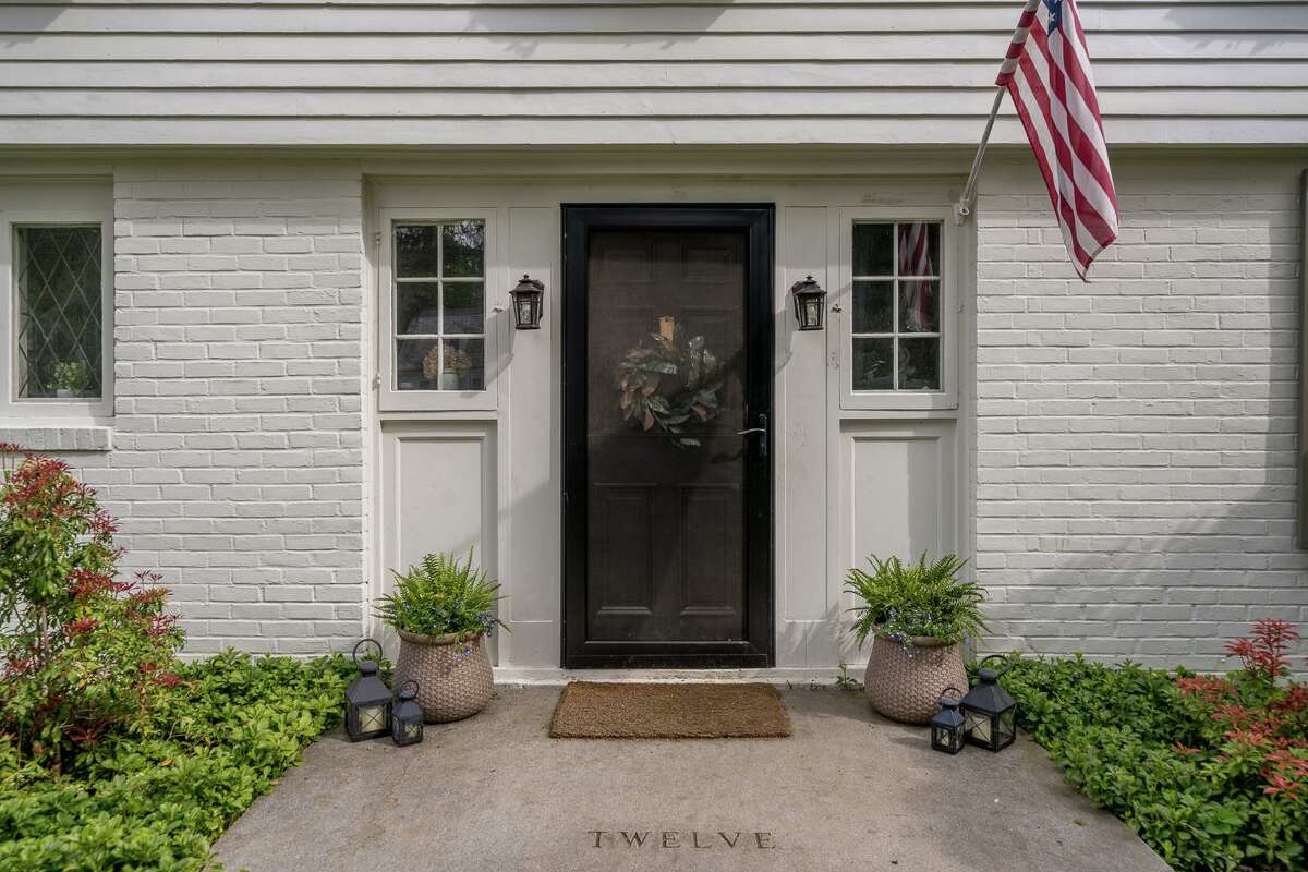 Most sidelights are stationary but the two six-paned sidelights that flank the front door are windows that can open.