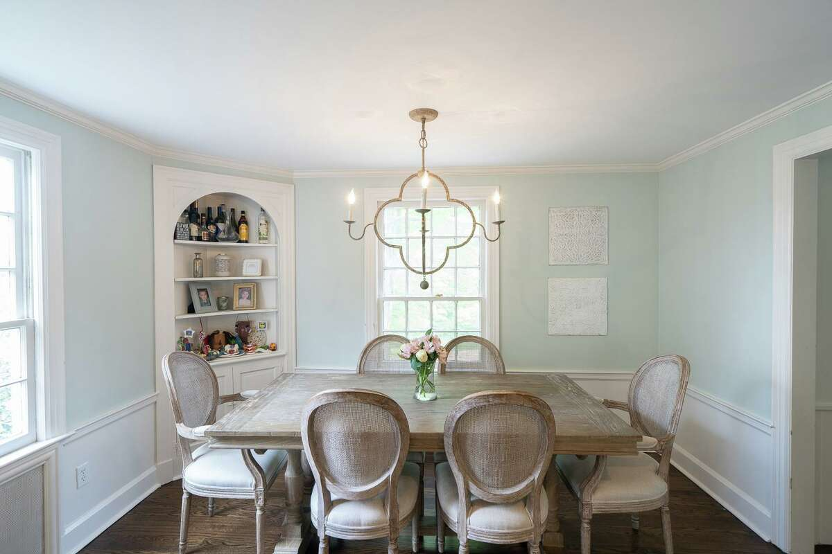 In the formal dining room there is a built-in corner cupboard.