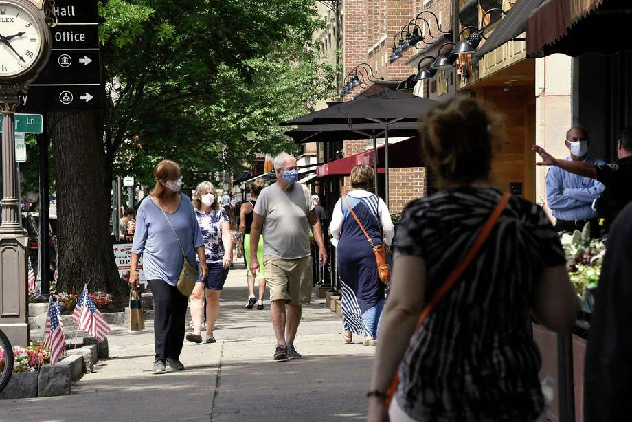 Pedestrians walk on the sidewalk along Broadway on Wednesday, July 1, 2020 in Saratoga Springs, N.Y. (Lori Van Buren/Times Union) Photo: Lori Van Buren, Albany Times Union