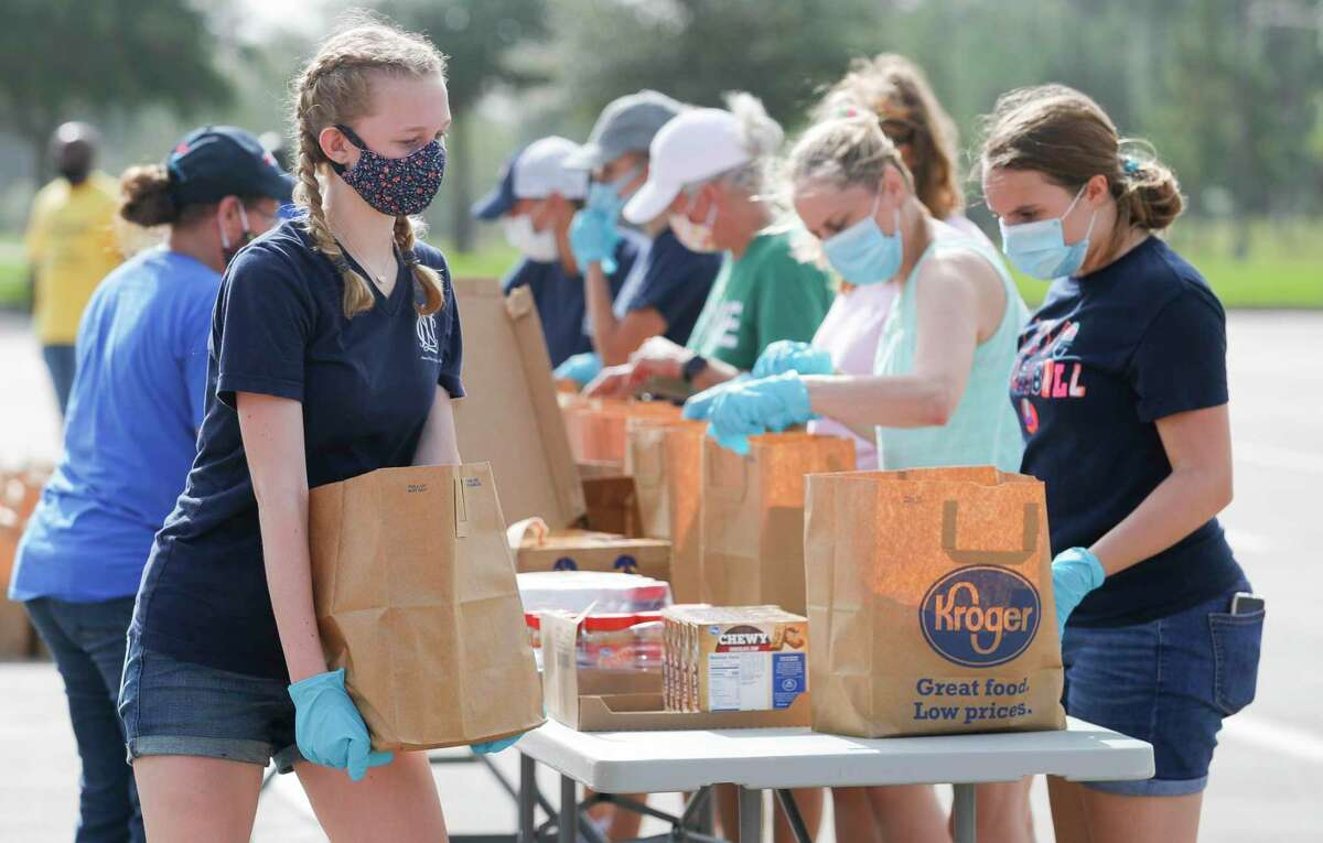 As Community Assistance Center and Interfaith of The Woodlands host a mobile food pantry at Woodforest Bank Stadium, Wednesday, July 1, 2020, in Shenandoah.