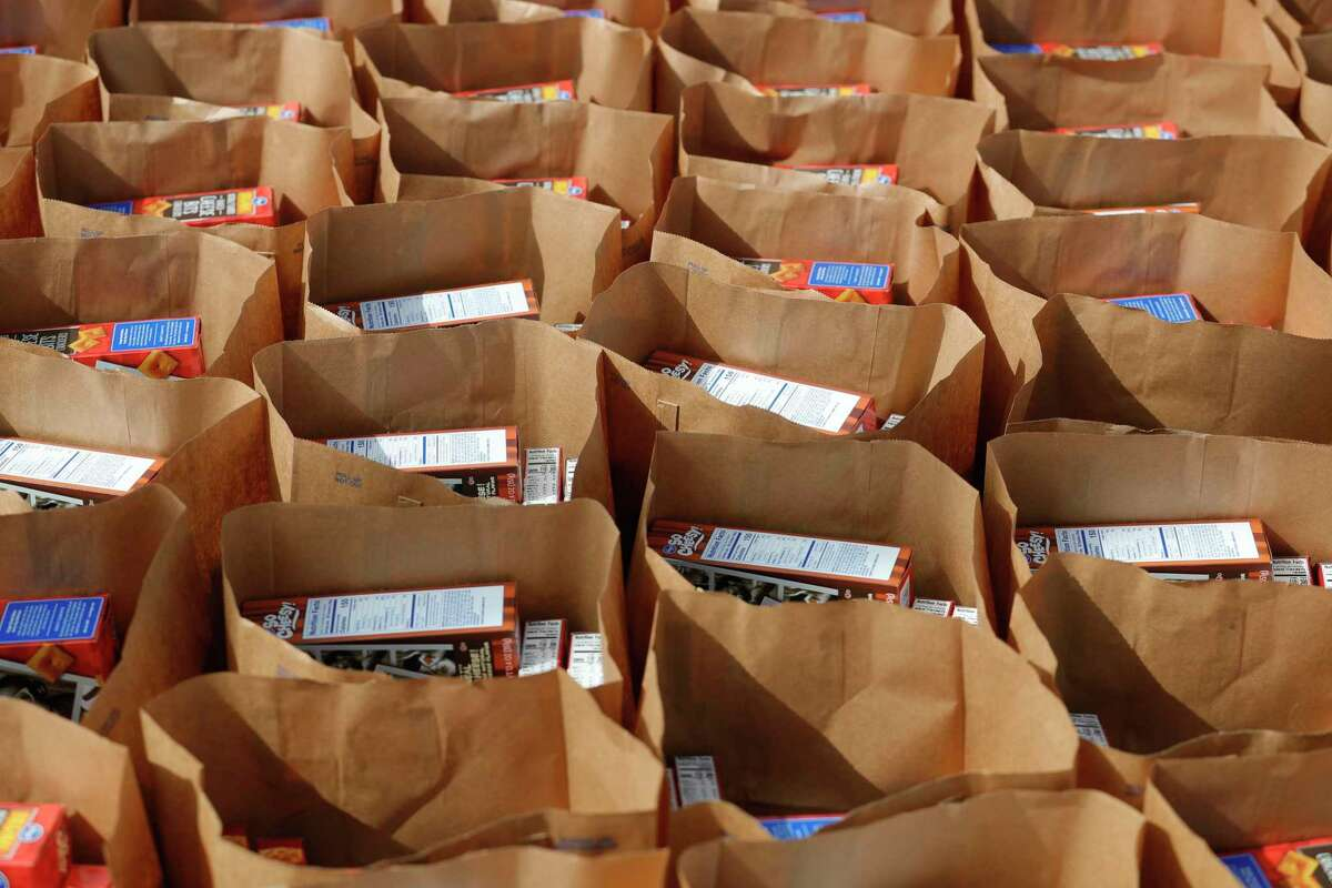 Bags of groceries are seen as Community Assistance Center and Interfaith of The Woodlands host a mobile food pantry for 600 families at Woodforest Bank Stadium, Wednesday, July 1, 2020, in Shenandoah.