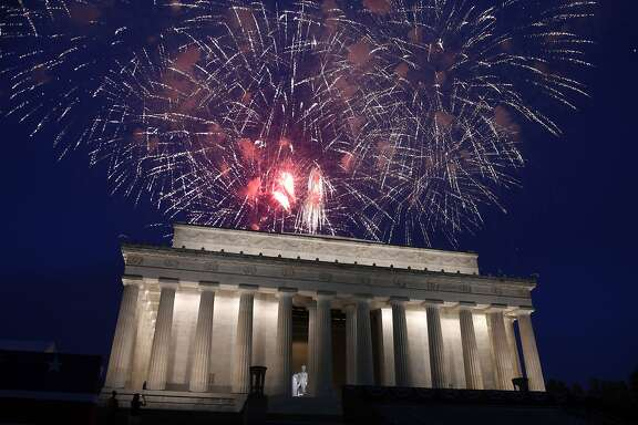 FILE - In this July 4, 2019 file photo, fireworks go off over the Lincoln Memorial in Washington, Thursday, July 4, 2019. The Trump administration is promising one of the largest fireworks displays in recent memory for Washington on July 4. It also plans to give away as many as 300,000 face masks to those who come down to the National Mall, although they won't be required to wear them. (AP Photo/Susan Walsh)