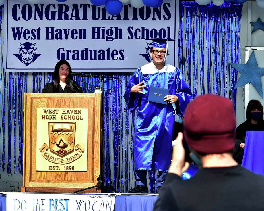 West Haven High School held  a drive-in graduation ceremony Tuesday, with seniors arrivingin waves of 35 cars at a time, walking up to the stage to  receive their diploma, and having  their photograph taken. Approximately 381 seniors graduated in the class of 2020. Photo: Peter Hvizdak / Hearst Connecticut Media / New Haven Register