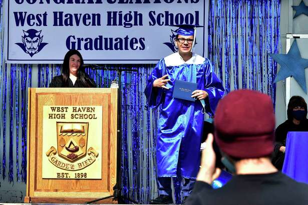 West Haven High School held a drive-in graduation ceremony Tuesday, with seniors arrivingin waves of 35 cars at a time, walking up to the stage to receive their diploma, and having their photograph taken. Approximately 381 seniors graduated in the class of 2020.
