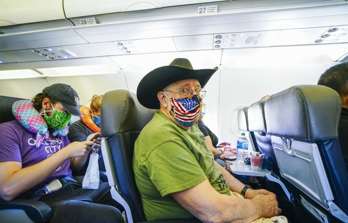 SAN DIEGO, CA - MAY 20: Passengers onboard an American Airlines flight to Charlotte, NC at San Diego International Airport on May 20, 2020 in San Diego, California. Air travel is down as estimated 94 percent due to the coronavirus (COVID-19) pandemic, causing U.S. airlines to take a major financial hit with losses of $350 million to $400 million a day and nearly half of major carriers airplanes are sitting idle. (Photo by Sandy Huffaker/Getty Images)