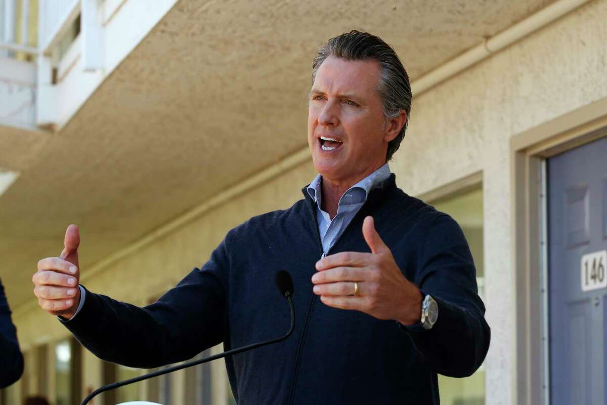Gov. Gavin Newsom gives an update on the state's initiative to provide housing for homeless Californians to help stem the coronavirus, during a visit to a Motel 6 participating in the program in Pittsburg, Calif., Tuesday, June 30, 2020.