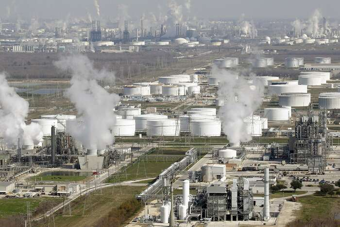 This Nov. 10, 2010 file aerial photo shows oil refineries, in Deer Park, Texas. North America, once a sponge that sucked in a significant portion of the world's oil, will instead be supplying the world with oil and other liquid hydrocarbons by the end of this decade, according to ExxonMobil's annual long-term energy forecast released Tuesday, Dec. 9, 2014. (AP Photo/David J. Phillip, File)