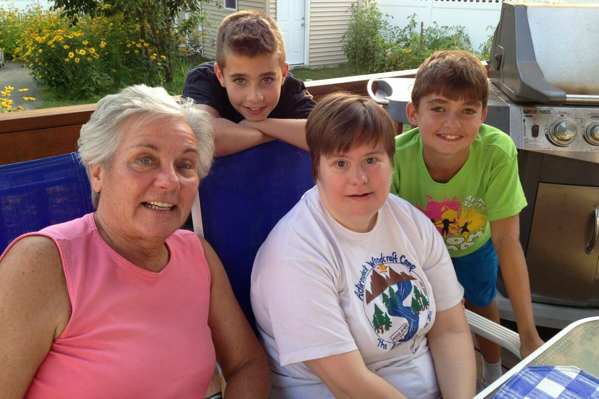 Wildwood Programs group home resident Heidi Schroder, center, is shown visiting with her mother, Joanne Long, and nephews. Under coronavirus restrictions, Schroder and other group homes residents are no longer allowed home visits, and some advocates for the developmentally disabled are asking that restrictions be lifted. (Photo submitted by Joanne Long)