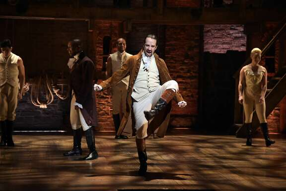"""NEW YORK, NY - FEBRUARY 15: Actor, composer Lin-Manuel Miranda performs on stage during """"Hamilton"""" GRAMMY performanc rehearsal for The 58th GRAMMY Awards at Richard Rodgers Theater on February 15, 2016 in New York City. (Photo by Theo Wargo/WireImage)"""
