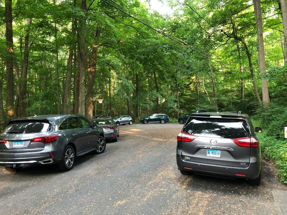 Neighbors worry that the town purchase of open space at the end of Craigmoor Road will bring traffic to their neighborhood. They submitted to the selectmen this photo of cars parked around the cul de sac. Photo: Contributed Photo