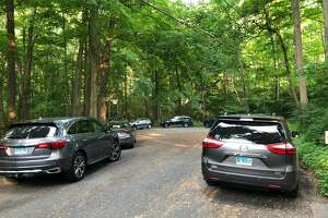 Neighbors worry that the town purchase of open space at the end of Craigmoor Road will bring traffic to their neighborhood. They submitted to the selectmen this photo of cars parked around the cul de sac.