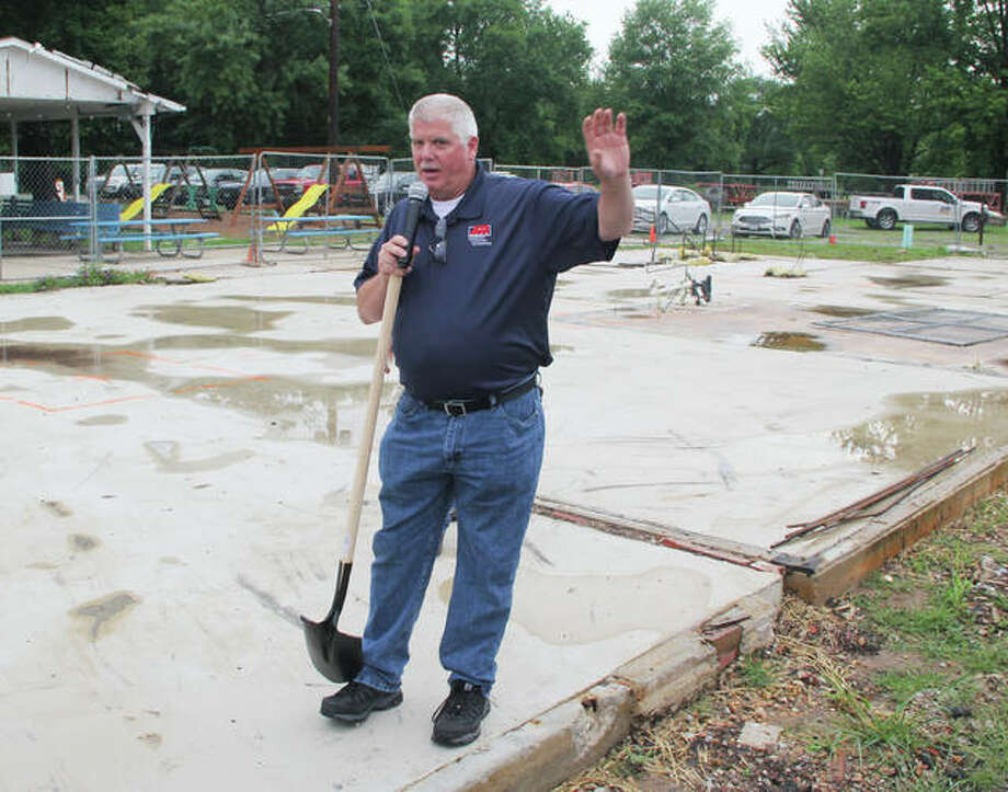 Alton Motor Boat Club Board Chairman James Neumann calls members over for a group photograph during a groundbreaking for their new clubhouse. A raised 4,000-square foot building, it will replace a structure deemed too damaged to repair after the 2019 flood.