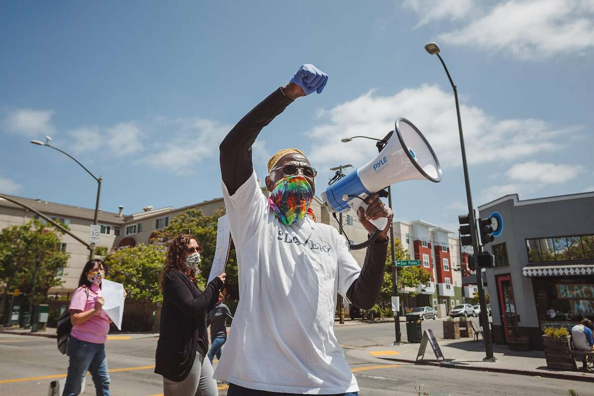 Parishoner Timothy Gholston participates in a Black Lives Matter protest outside of St. Columba Catholic Church in Oakland, Calif. on Sunday, June 28, 2020.