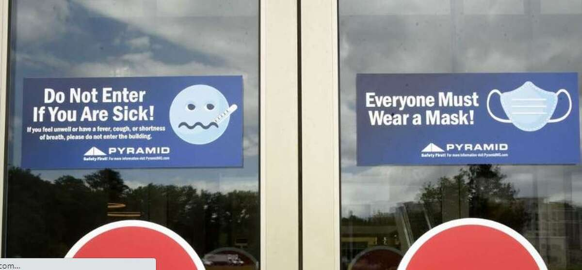 Safety signs are seen on the doors at Crossgates Mall.