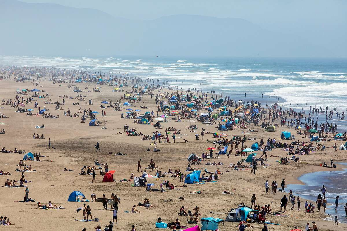 Crowds gather at Ocean Beach in San Francisco, Calif. Monday, May 25, 2020. The warm Memorial Day weather brought out large crowds to popular parks and beaches despite the shelter-in-place order amid the COVID-19 pandemic.
