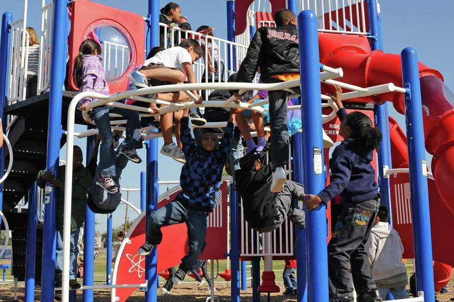 McWhirter Elementary School students try out the playground equipment at the new Spark Park dedicated during a ceremony at the school Friday, Nov. 18. / Internal