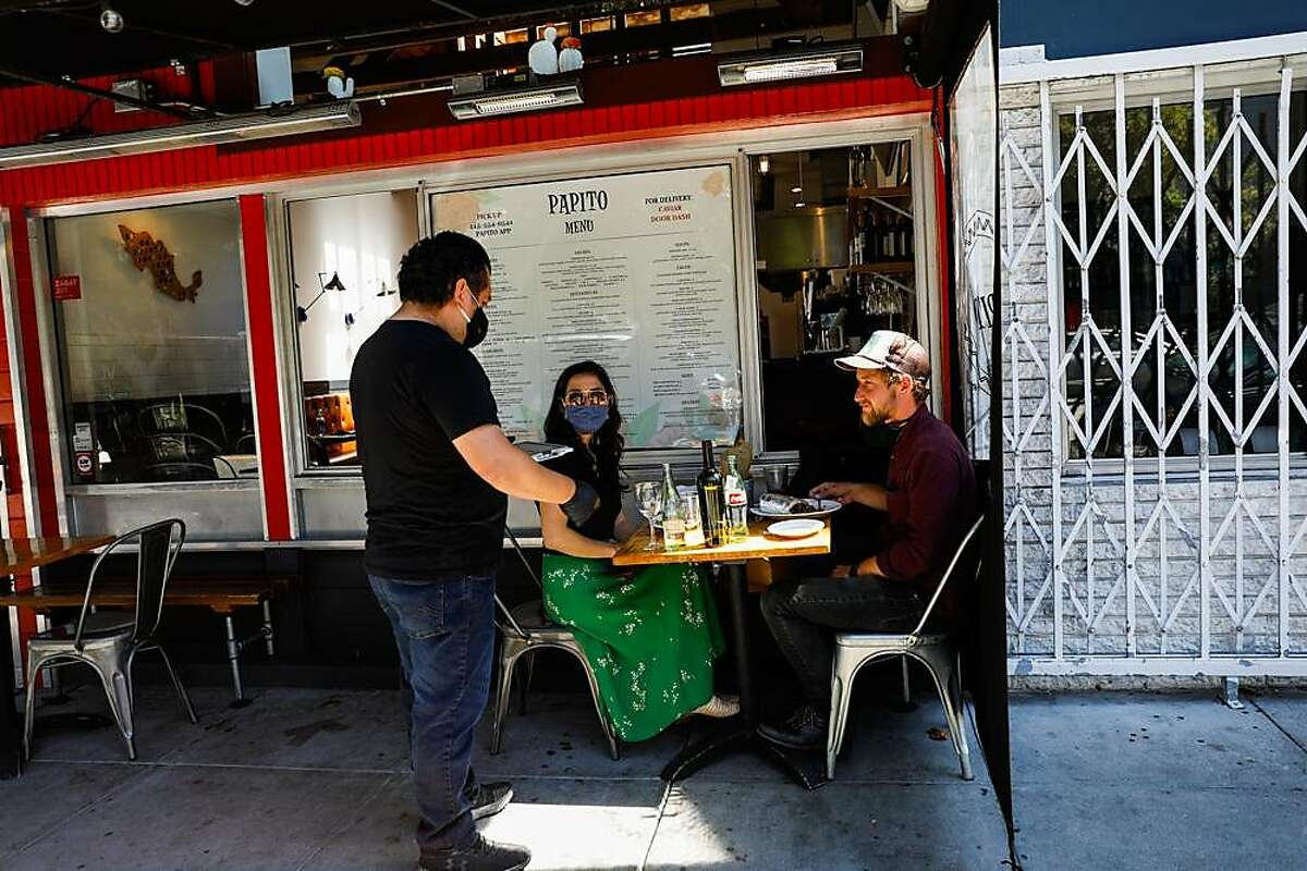 People who wished to remain anonymous eat outdoors at Papito restaurant in Hayes Valley on Wednesday, June 17, 2020 in San Francisco, California.