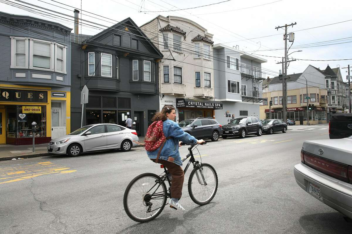 Tenant Alexa Lewis lives in a flat in creme colored building seen across the street on Thursday, April 30, 2020, in San Francisco, Calif.